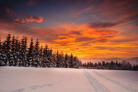 Winter evening in Polish Beskid mountains.Sunset on stecówka mountain in Istebna.
