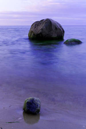 shingle beach: Morning light on the water, with the shingle beach  Stock Photo