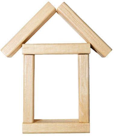 Symbolic wooden house blocks photo