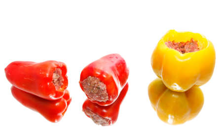 Three stuffed peppers with minced meat on white background  photo
