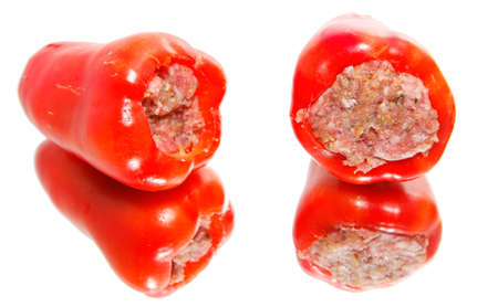 Two green peppers stuffed with minced meat, raw  photo