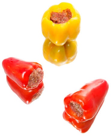 Red and yellow bell peppers stuffed with meat  photo