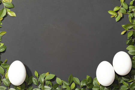 Slate slate optic framed with elm branches These eggs as a symbol of Easter  photo