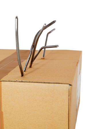 Box of damage caused by nails on white  Stock Photo - 18309776
