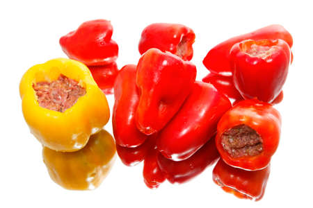 Red and yellow peppers stuffed with minced meat, before baking. Stock Photo - 18311413