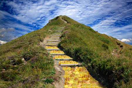 unstoppable: Golden road to the mountain top to the target  Stock Photo