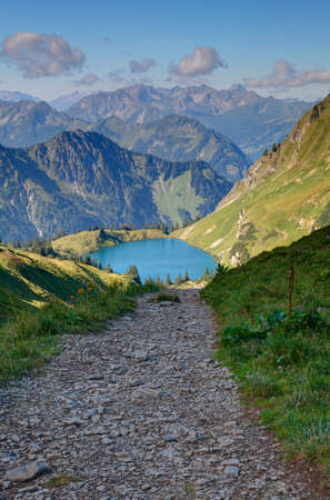 off path: Trail to the alpine lake