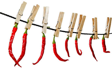 parentheses: Red chilli peppers on a clothesline  Stock Photo