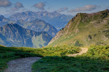 off path: Hiking in high mountains, Alps, in summer