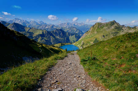 off path: Trail to the high mountain in the Alps Stock Photo