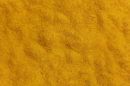 Was ground turmeric with yellow color, background. Imagens
