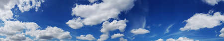 Blue summer sky with fleecy clouds as a panorama.