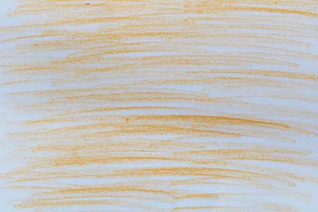 Orange chalk slices on pape 免版税图像