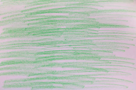 Green chalk marks on paper.