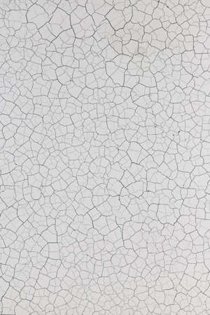 Paint cracked and brittle in black and white.