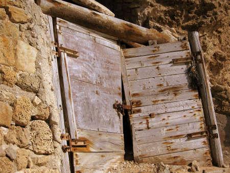 very old wooden street door close up,old awry door,old wooden door photo