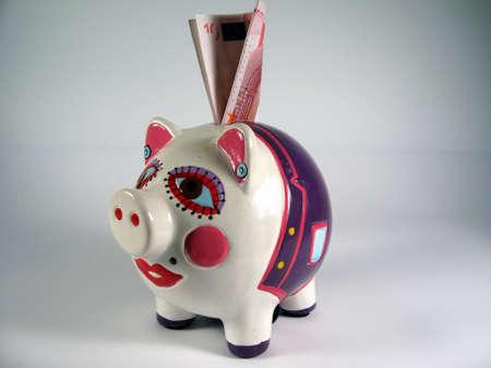piggy bank,pink ceramic ,piggy bank with a money photo