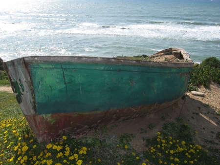 Old boat on sea photo