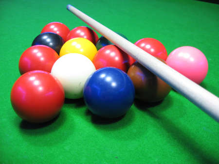 billiards balls on a green table  Stock Photo