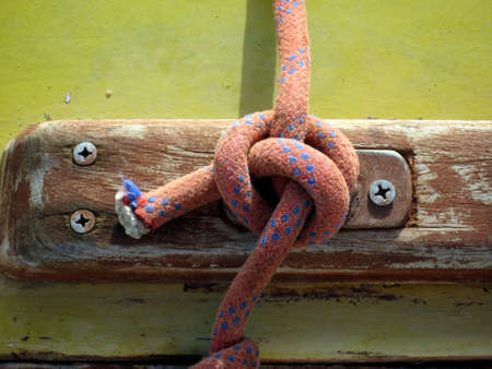 cleat: detail yacht rope tied around cleat  Stock Photo