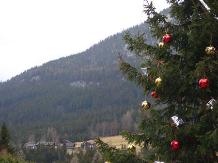Christmas-tree with the toys against the background of mountain photo