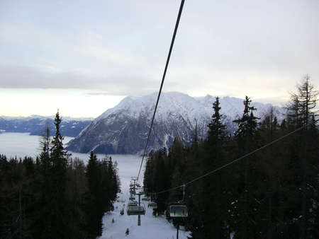 elevator cable between trees in mountains in the winter photo