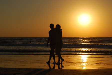 man and woman on the sea beach at the moment of sunset Stock Photo - 2492247