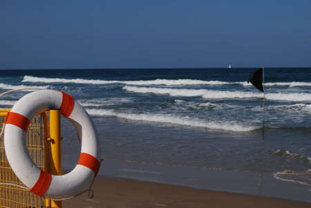 white buoy against the background sea and black flag photo