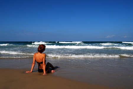 Woman on the beautiful beach of sea photo