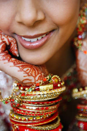 indian bride: Hand decorated with tatoo, bracelet and the braislet
