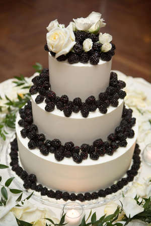 Cake decoraited with black berries photo