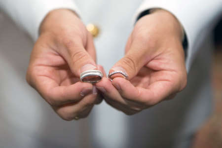 man is Holding Wedding rings in the hands