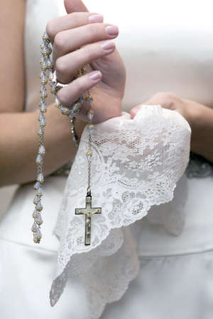 religious event: bride holding cross on the wedding ceremony