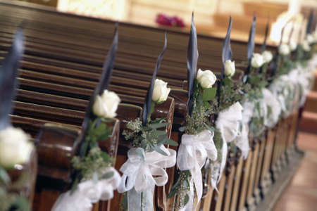 wedding chairs: white rose decorated aisle