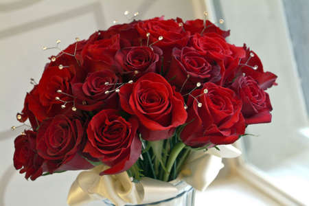 florists: red roses, wedding bouquet, close up image