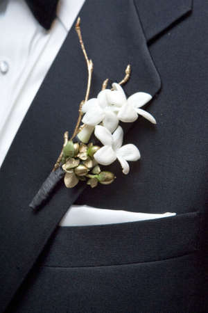 boutonniere: white boutonniere flower on the wedding date Stock Photo