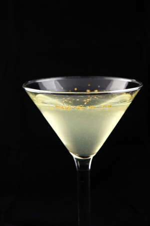 silver martini cocktail with elegante gold sprinkle decoration Stock Photo - 8822951