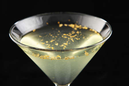 yellow martini cocktail with elegante red decoration