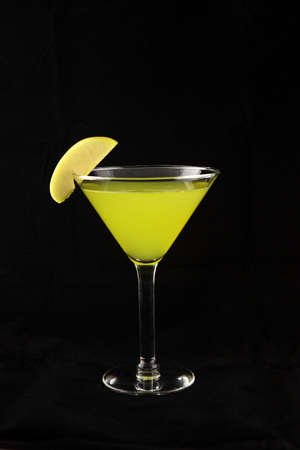 green martini cocktail with elegante lime decoration
