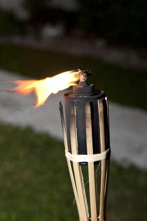 Decoration tiki oil torches burning outside Banco de Imagens