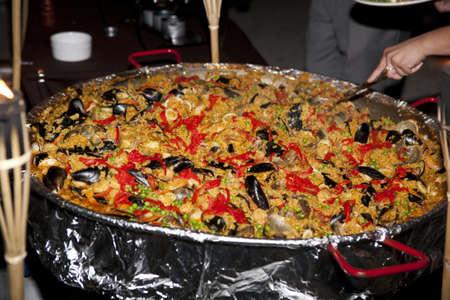 seafood paella rice dish made with seafood, sausage and saffron rice Banco de Imagens