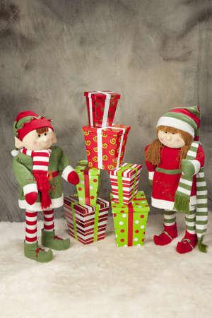 colorful Christmas presents and a elfs Banco de Imagens