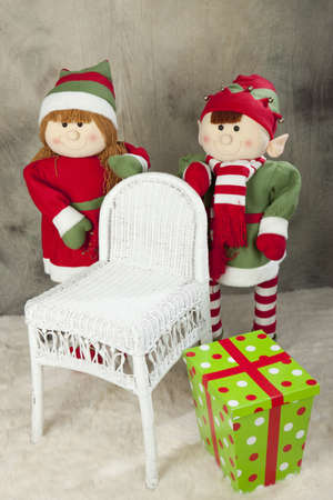 colorful Christmas presents and a elfs with the chair