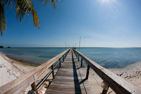 fishing Pier at the Florida with the clear blue sky, ocean view Banco de Imagens