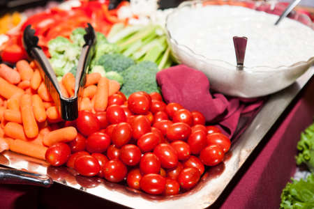Platter of assorted fresh vegetables with dip for healthy eating snack