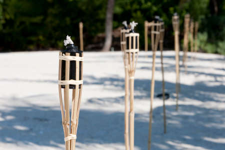 Decoration tiki oil torches burning outside Imagens