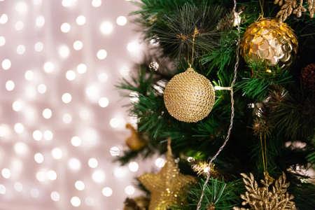 christmas tree with toys lights garland bokeh on background stock photo 97235768 - Christmas Tree With Garland