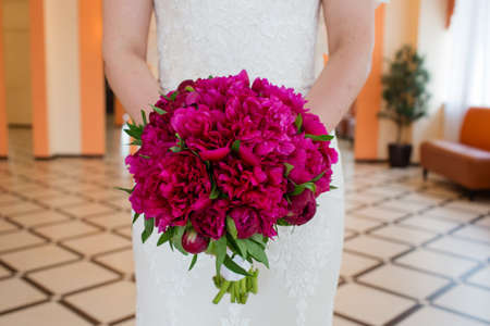 Wedding bouquet of flowers in the hands of the bride Stock fotó