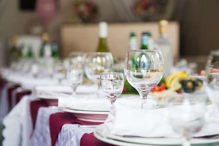 Wedding table with glasses, napkins and cutlery