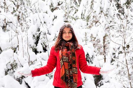 Woman in winter forest. Russian winter